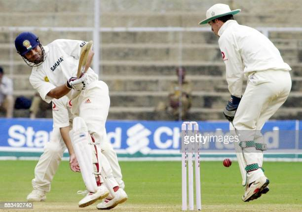 Indian batsman Sachin Tendulkar plays a sweep shot as England keeper James Foster tries to collect the ball during the prelunch session on the third...