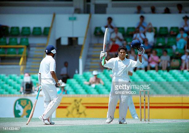 Indian batsman Sachin Tendulkar raises his bat after making a century on february 3 during a match against Australia in Perth