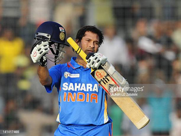 Indian batsman Sachin Tendulkar reacts after scoring his hundred century during the one day international Asia Cup cricket match between India and...