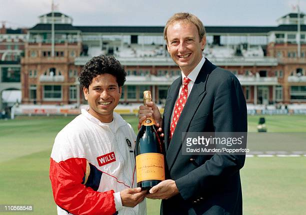 Indian batsman Sachin Tendulkar receives his award for the BBC Test match Special Champagne Moment from commentator Jonathan Agnew after the 2nd Test...