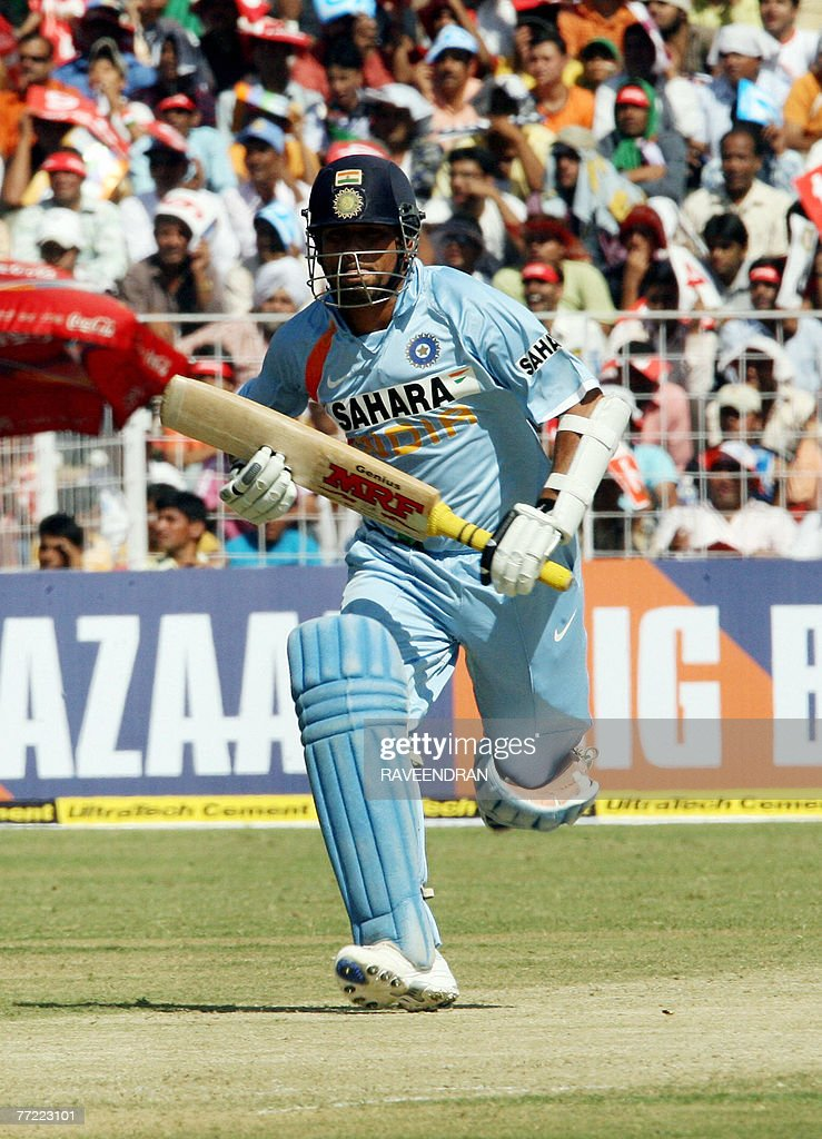Indian batsman Sachin Tendulkar takes a to complete his half century during the fourth OneDay International match against Australia in Chandigarh 08..
