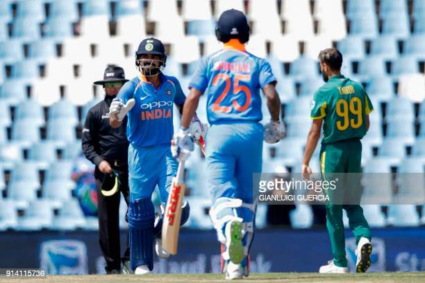 Indian batsman Shikhar Dhawan and Captain Virat Kohli take the last two run to win the match during the second day of the One Day International...