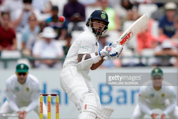 Indian batsman Shikhar Dhawan avoids a bouncer during the fourth day of the first Test cricket match between South Africa and India at Newlands...