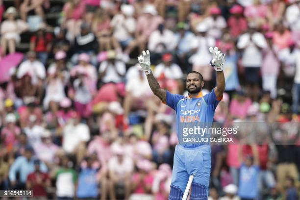 Indian batsman Shikhar Dhawan celebrates scoring a century during the fourth One Day International cricket match between South Africa and India at...