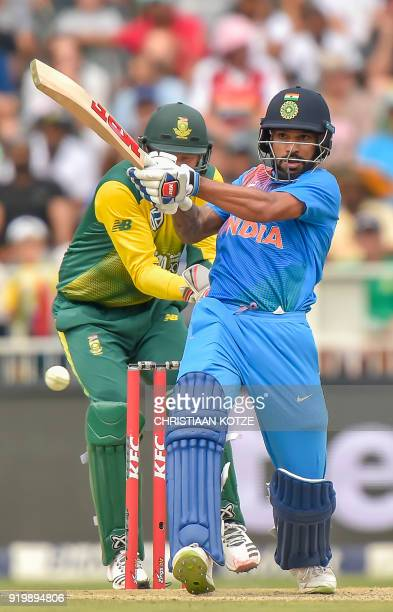 Indian batsman Shikhar Dhawan plays a shot during the first T20I cricket match between South Africa and India at The Wanderers Cricket Stadium in...