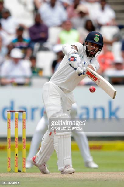 Indian batsman Shikhar Dhawan plays a shot during the fourth day of the first Test cricket match between South Africa and India at Newlands cricket...