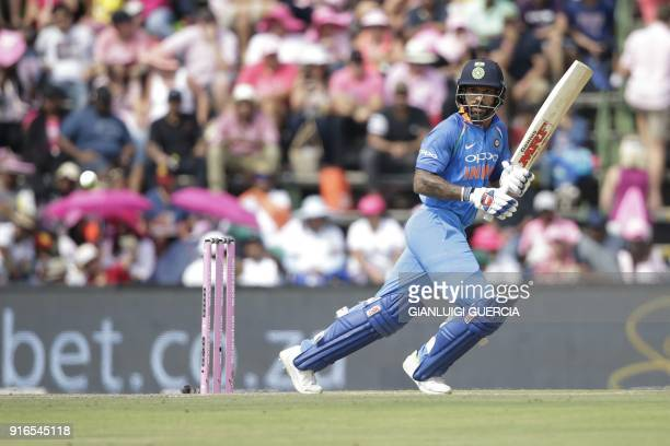 Indian batsman Shikhar Dhawan plays a shot during the fourth One Day International cricket match between South Africa and India at Wanderers cricket...