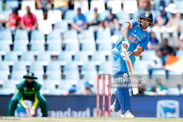 Indian batsman Shikhar Dhawan plays a shot during the second day of the One Day International cricket match between South Africa and India at the...
