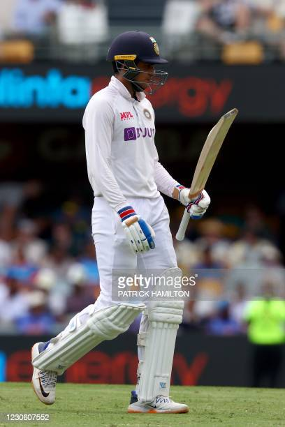 Indian batsman Shubman Gill departs after his dismissal off Australia's paceman Pat Cummins on day two of the fourth cricket Test match between...