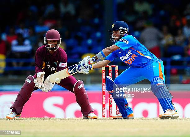 Indian batsman Subramaniam Badrinath plays a shot in front of West Indies wicketkeeper Carlton Baugh during the first ODI bewteen West Indies and...
