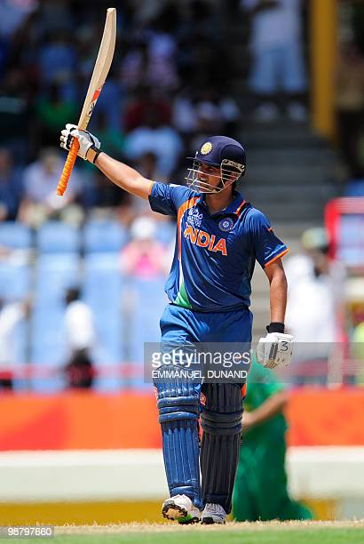 Indian batsman Suresh Raina celebrates after scoring a century during the ICC World Twenty20 Group C match between India and South Africa at The...
