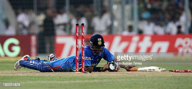 Indian batsman Suresh Raina dives to get back to the crease during 5th One Day International match between India and England at Eden Gardens' stadium...