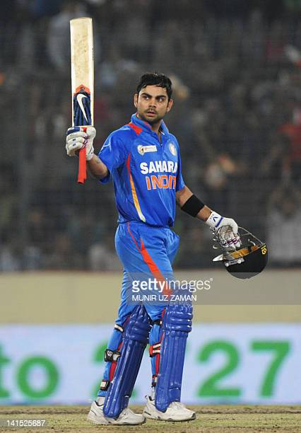 Indian batsman Virat Kholi reacts after scoring a century during the one day international Asia Cup cricket match between India and Pakistan at The...