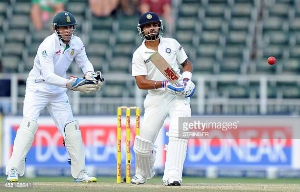 Indian batsman Virat Kohli bats next to South African wicket keeper AB de Villiers on the third day of a cricket Test match between South African and...