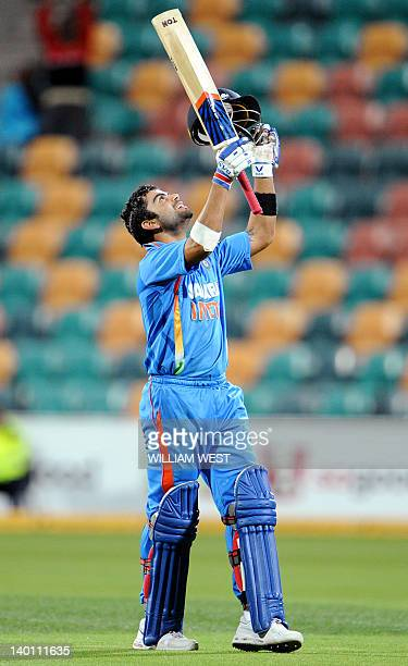 Indian batsman Virat Kohli celebrates scoring his century against Sri Lanka in their international one day cricket match played in Hobart on February...