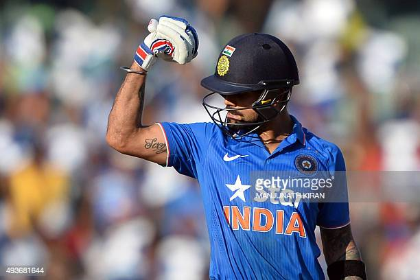 Indian batsman Virat Kohli gestures after scoring 100 runs during the fourth one day international cricket match between India and South Africa at...