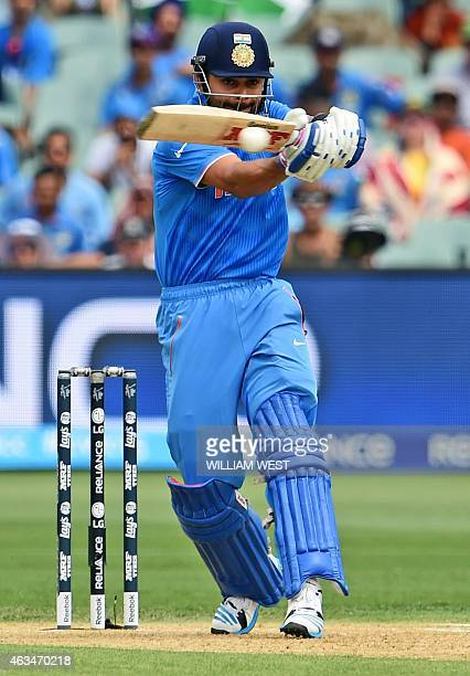 Indian batsman Virat Kohli hooks a ball away to the boundary from the Pakistan bowling in their 2015 Cricket World Cup match in Adelaide on February...