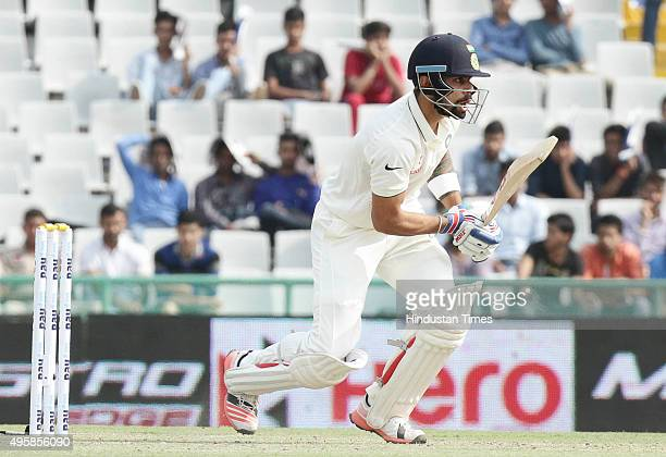 Indian batsman Virat Kohli reacts as he was caught by fielder during the test match played against South Africa at PCA Stadium on November 5 2015 in...