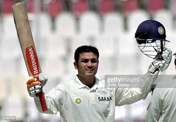 Indian batsman Virender Sehwag celebrates after scoring his triple century during the second day of the first Test match between Pakistan and Indian...