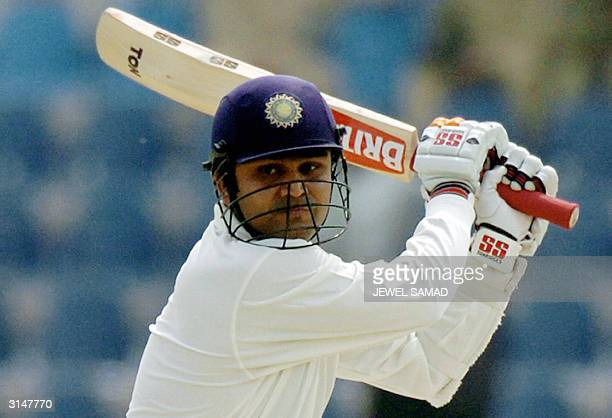Indian batsman Virender Sehwag hits boundary off Pakistani bowler Shoaib Akhtar during the first day of the first Test match between Pakistan and...