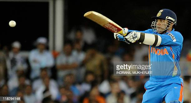 Indian batsman Virender Sehwag plays a shot during the quarterfinal match of The ICC Cricket World Cup 2011 between India and Australia at The Sardar...