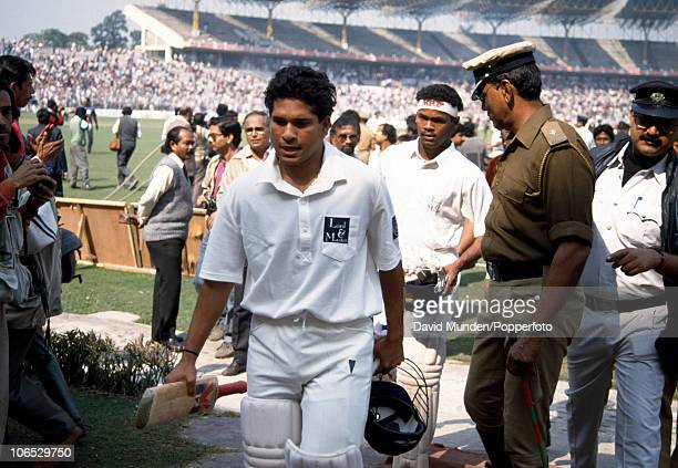 Indian batsmen Sachin Tendulkar and Vinod Kambli leave the field at the end of the 1st Test match between India and England at Eden Gardens in...