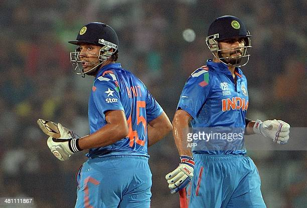 Indian batsmen Virat Kohli and Rohit Sharma run between the wickets during the ICC World Twenty20 tournament cricket match between India and...