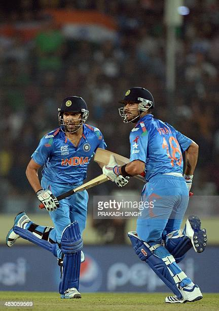 Indian batsmen Virat Kohli and Rohit Sharma run between the wickets during the ICC World Twenty20 final cricket match between India and Sri Lanka at...