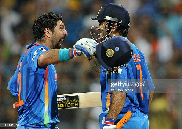 Indian batsmen Yuvraj Singh and Mahendra Singh Dhoni celebrate victory over Sri Lanka during the ICC Cricket World Cup 2011 final played at The...