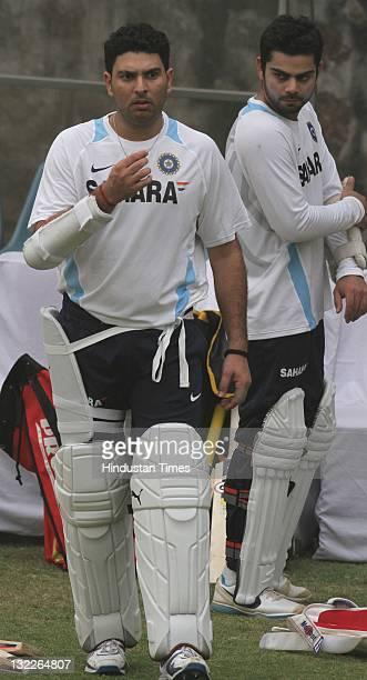 Indian batsmen Yuvraj Singh and Virat Kohli during a training session on November 4 2011 at The Feroz Shah Kotla Stadium in New Delhi India