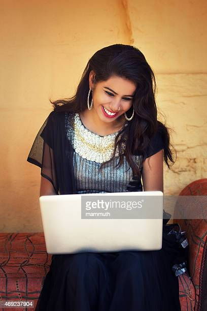 Indian beauty using laptop