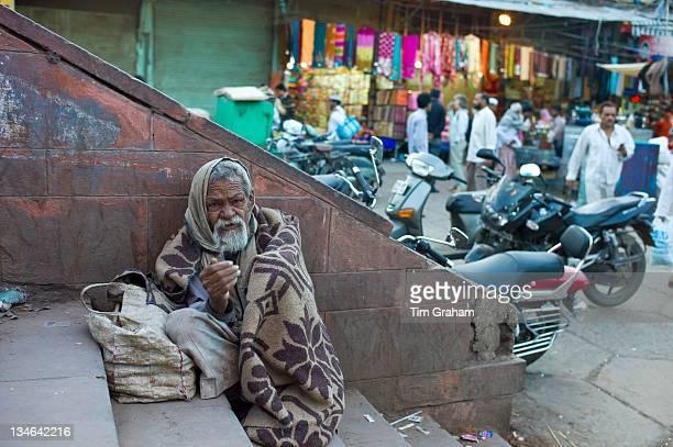 Indian beggar at muslim Meena Bazar in Old Delhi India