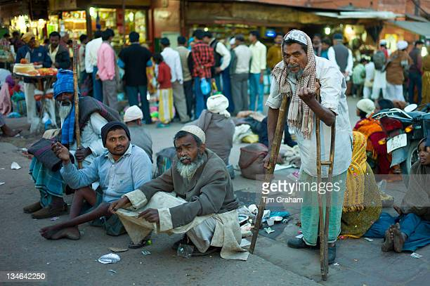 Indian beggars at muslim Meena Bazar in Old Delhi India