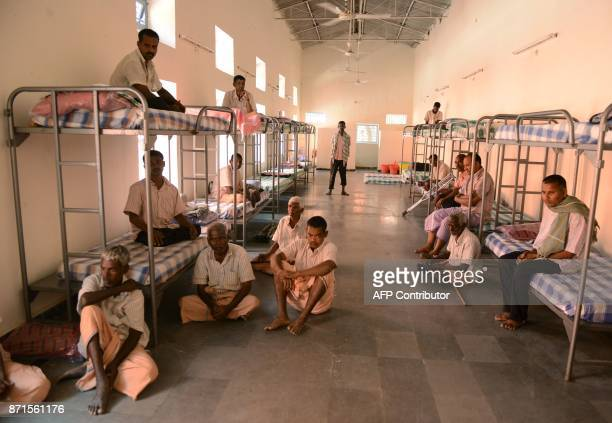 TOPSHOT Indian beggers who were brought to a shelter after begging on the streets sit inside a dormitory in Hyderabad on November 8 2017 The southern...