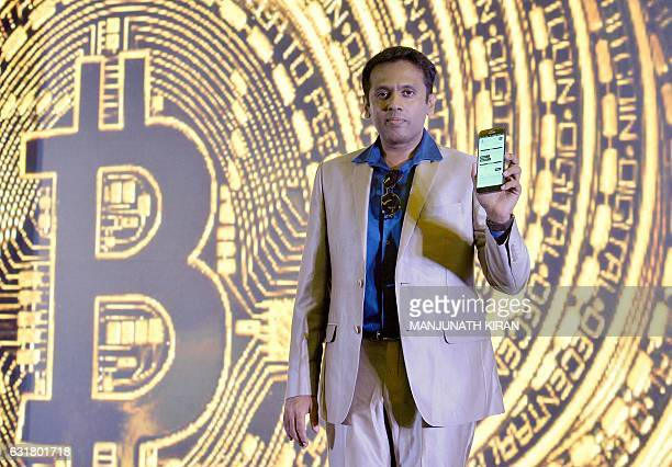 Indian Belfrics CEO of Praveen Kumar poses for a photograph at a press conference during the launch of the firms's Indian Bitcoin exchange operations...