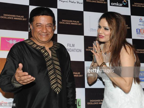 Indian Bhajan singer Anup Jalota and actress Poonam Jhawer pose as they attend the Dadasaheb Phalke Excellence Awards Ceremony 2017 in Mumbai on...