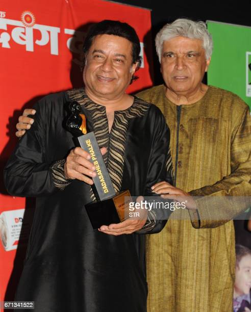 Indian Bhajan singer Anup Jalota and poet lyricist and screenwriter Javed Akhtar pose as they attend the Dadasaheb Phalke Excellence Awards Ceremony...