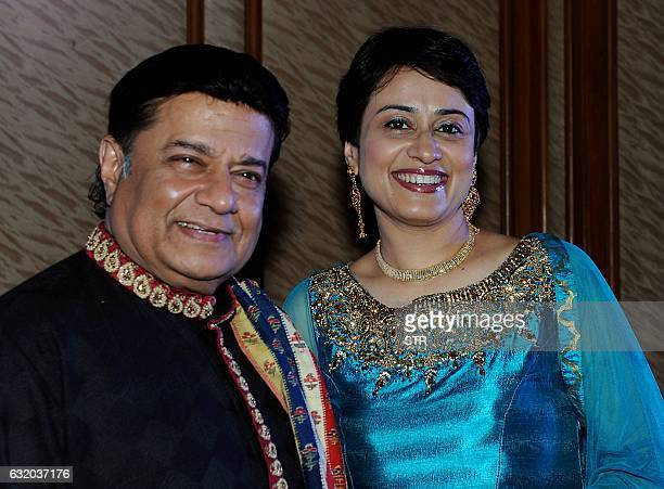 Indian bhajan singer Anup Jalota and singer Kakoly Borthakur pose for a photograph during a promotional event in Mumbai on late January 18 2017 / AFP...