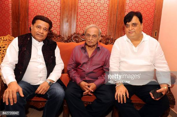 Indian Bhajan singer Anup Jalota music composer Anandji and producer Om Chhangani attend the music launch of the upcoming Hindi film Mr Kabaadi in...