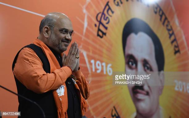 Indian Bharatiya Janata Party President Amit Shah gestures at the start of a press conference at the party headquarters in New Delhi on December 18...