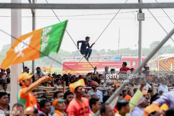 Indian Bharatiya Janata Party supporters attend an election rally of Prime Minister Narendra Modi in Muzaffarpur in the eastern state of Bihar on...