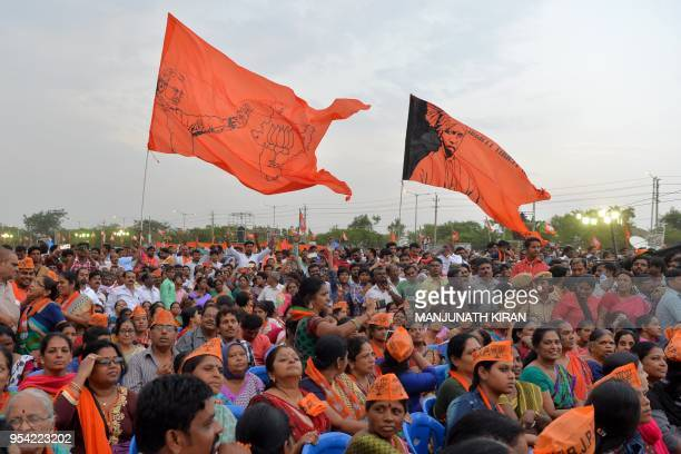Indian Bharatiya Janata Party supporters take part in an election campaign rally held in Bangalore on May 3 2018 The Indian state of Karnataka is...