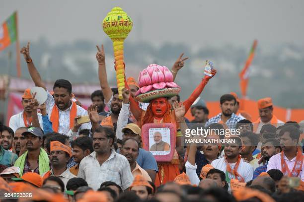 TOPSHOT Indian Bharatiya Janata Party supporters take part in an election campaign rally held in Bangalore on May 3 2018 The Indian state of...