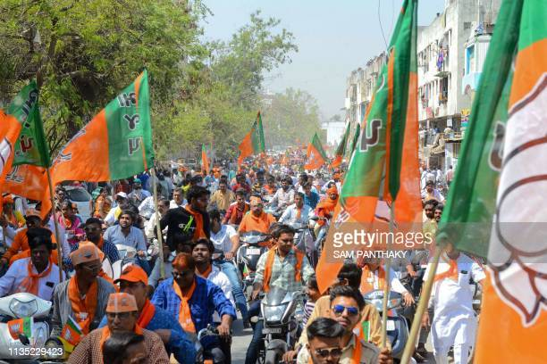 Indian Bharatiya Janta Party supporters gather to follow BJP National President Amit Shah during his road show in Ahmedabad on April 6 2019 India is...