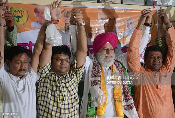 Indian Bhartiya Janata Party candidate for the Darjeeling constituency SS Ahluwalia poses with Gorkha People's Liberation Front general secretary...
