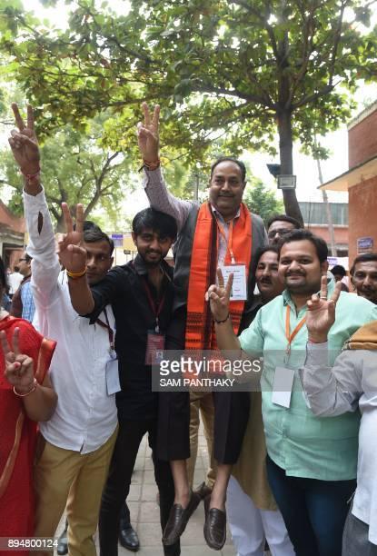Indian Bhartiya Janta Party candidate from the Vejalpur constituency Kishorbhai Babulal Chauhan celebrates after winning the Gujarat Vidhan Sabha...