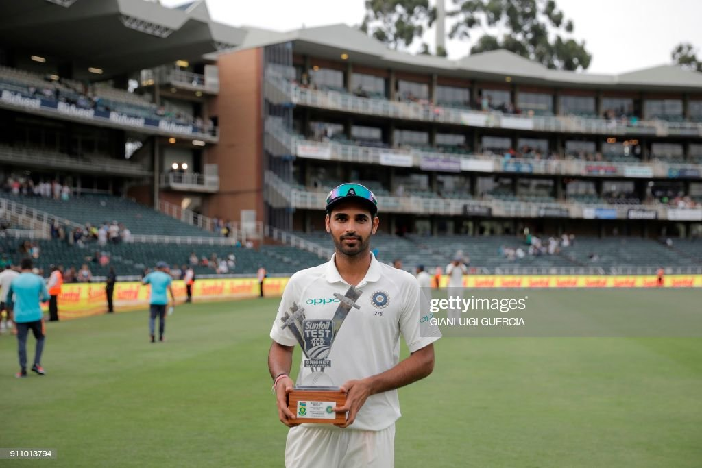 Indian Bhuvneshwar Kumar poses with his trophy for Man of the Match after the fourth day of the third Test match between South Africa and India at Wanderers cricket ground in Johannesburg on January 27, 2018. India beat South Africa by 63 runs on the fourth day of the third and final Test at the Wanderers Stadium on January 27. /