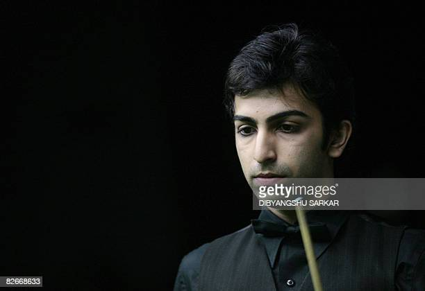 Indian billiards player Pankaj Advani loos on during his points final match against compatriot Geet Sethi during the International Billiards and...