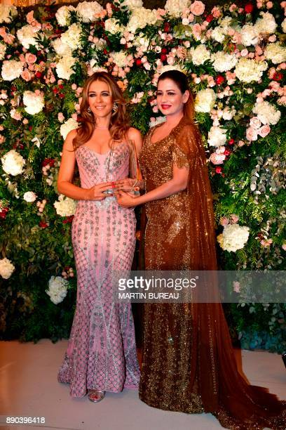 Indian billionaire Sudha Reddy poses with British actress Liz Hurley in Paris on December 11 2017 during a charity dinner in Reddy's honour after she...