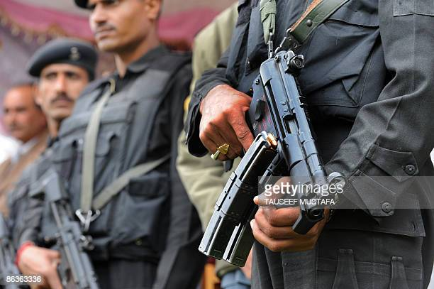 Indian 'Black Cat' commandoes stand guard with their weapons during an election campaign rally attended by Farooq Abdullah, the former state chief...